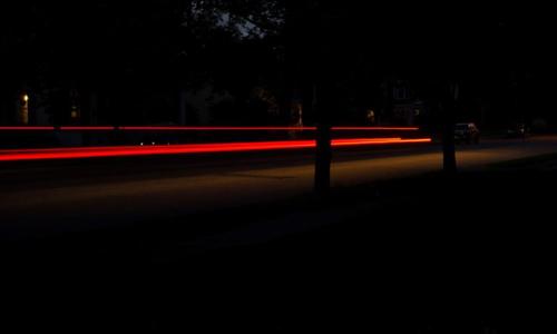 Red laser light on a dark street